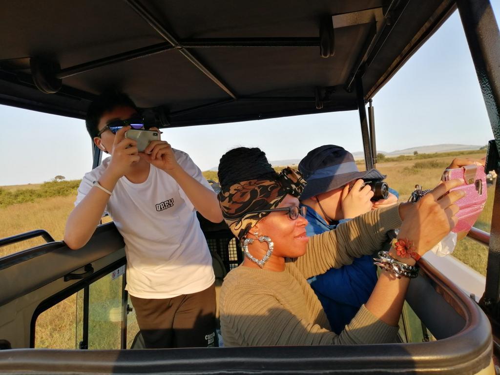 Guests on Safari In Masai Mara - Cheetah Safari Jeeps - Cheetah Safaris